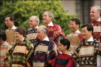 President George W. Bush participates in bilateral meetings and a family photo op at La Moneda during the 2004 APEC Summit.